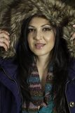 Young beautiful woman with big hairy winter jacket Stock Photos