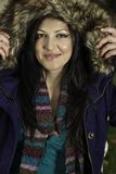 Young beautiful woman with big hairy winter jacket Royalty Free Stock Images