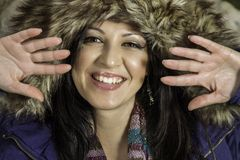 Young beautiful woman with big hairy winter jacket Stock Image
