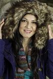 Young beautiful woman with big hairy winter jacket Royalty Free Stock Photography
