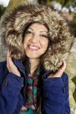 Young beautiful woman with big hairy winter jacket Stock Photo