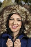 Young beautiful woman with big hairy winter jacket Royalty Free Stock Image