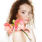 Young beautiful woman with big pink flowers Royalty Free Stock Photography