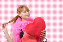 Young beautiful woman with big red heart pillow Stock Image