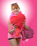 Young beautiful woman with big red heart pillow Stock Photo