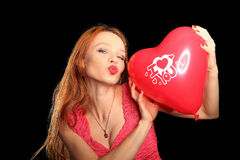 Young beautiful woman with big red heart Stock Photography