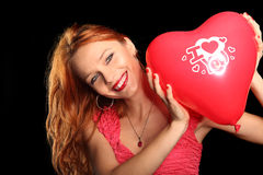 Young beautiful woman with big red heart Royalty Free Stock Photos