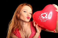 Young beautiful woman with big red heart Stock Photo