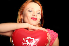 Young beautiful woman with big red heart Royalty Free Stock Photography