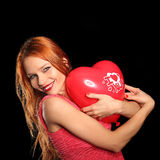 Young beautiful woman with big red heart Royalty Free Stock Images
