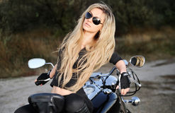 Young beautiful woman on a bike Royalty Free Stock Image