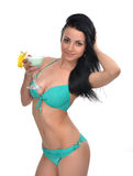 Young beautiful woman in bikini drinking margarita cocktail juic Royalty Free Stock Photo