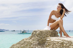 Young beautiful woman in bikini on sea background Stock Photo