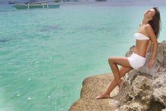 Young beautiful woman in bikini on sea background Royalty Free Stock Images