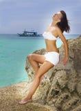 Young beautiful woman in bikini on sea background Stock Image