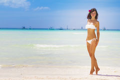 Young beautiful woman in bikini on sea background Stock Photo