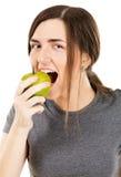 Young beautiful woman biting a fresh apple Stock Photo