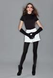 Young beautiful woman in black combi dress Stock Image