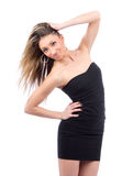 Young beautiful woman in black dress Royalty Free Stock Photography