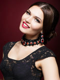 Young beautiful woman in black dress on marsala color background Royalty Free Stock Photos