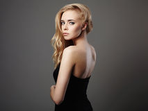 Young beautiful woman in black dress.Sexy Blond girl Royalty Free Stock Image