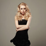 Young beautiful woman in black dress.Sexy Blond girl Stock Photography