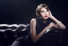 Young beautiful woman in black dress Royalty Free Stock Images