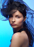 Young beautiful woman in black hat Stock Images