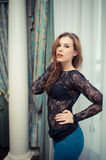 Young beautiful woman in black lace top beside Royalty Free Stock Photo