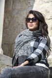Young beautiful woman with black scarf against stone wall Stock Image