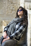 Young beautiful woman with black scarf against stone wall Stock Photos