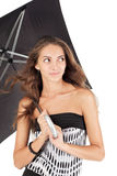 Young beautiful woman with black umbrella Royalty Free Stock Photo