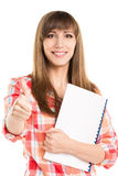 Young beautiful woman with blank notebook show thumb up Stock Photos