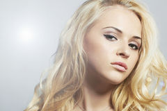 Young beautiful woman.Blond girl. Curly hairstyle Stock Photos