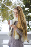 Young beautiful woman with blond hair outdoor with cup Stock Images