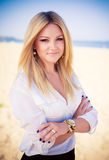 Young beautiful woman blonde poses on a beach Royalty Free Stock Images