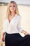 Young beautiful woman blonde poses on a beach Stock Photography