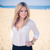 Young beautiful woman blonde poses on a beach Stock Images