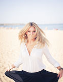 Young beautiful woman blonde poses on a beach Royalty Free Stock Photography
