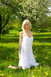 Young beautiful woman in blooming gardens Stock Photo