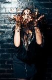 Young beautiful woman blowing сonfetti on party event Stock Images
