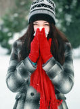 Young beautiful woman blowing nose in winter Stock Photos