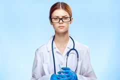 Young beautiful woman on a blue background with glasses and a medecine gown, medicine, doctor stock photos