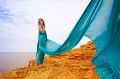 Young beautiful woman in blue dress Royalty Free Stock Image