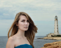 Young beautiful woman in blue dress Royalty Free Stock Photography