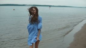 Young beautiful woman at the beach stock video footage