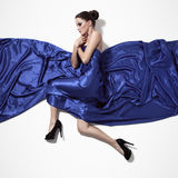 Young beautiful woman in blue dress. Royalty Free Stock Images