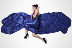 Young beautiful woman in blue dress. Stock Image