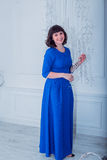 Young beautiful woman in blue elegant evening dress Stock Photography