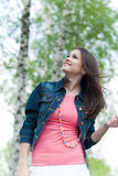 Young Beautiful woman in blue jeans jacket Royalty Free Stock Photo
